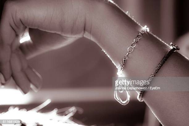 close-up of a bracelet on womans wrist - bracelet stock pictures, royalty-free photos & images