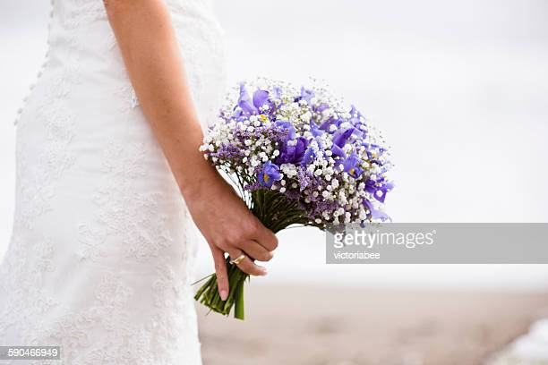 Close-up of a bride holding a bouquet of flowers