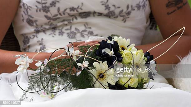 Close-up of a bride with wedding bouquet