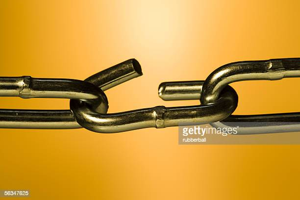 close-up of a broken link in a chain - link chain part stock photos and pictures