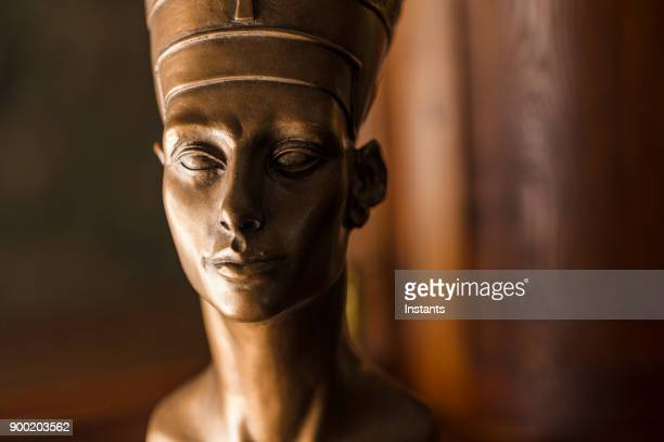 close-up of a bronze colored nefertiti bust, made with plaster. - nefertiti stock pictures, royalty-free photos & images