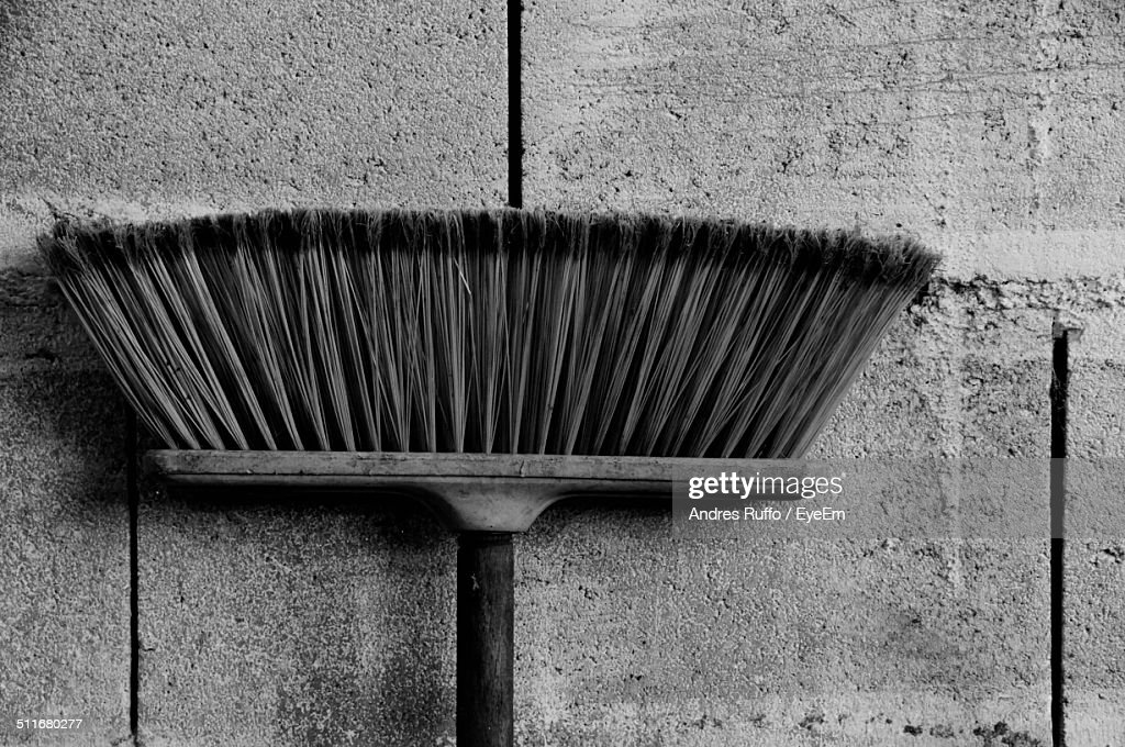 Close-up of a broom against the wall : Stock Photo