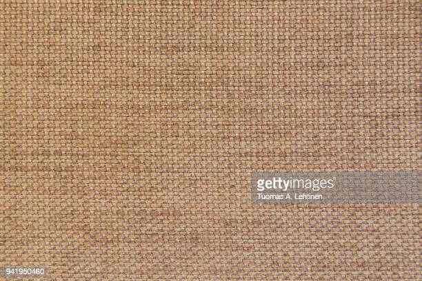 Close-up of a brown furniture fabric texture, abstract background