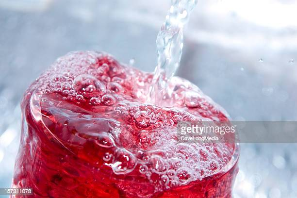 Close-up of a bubbly red drink