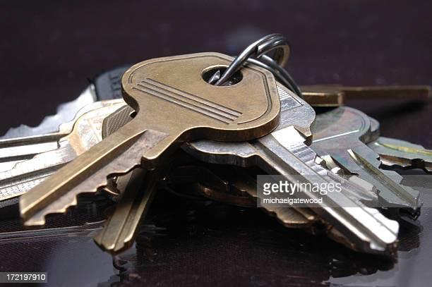 close-up of a bunch of keys on a desk - locksmith stockfoto's en -beelden