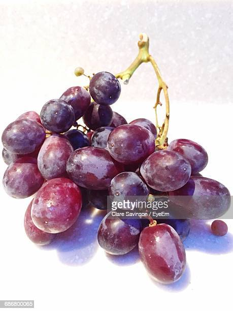 Close-Up Of A Bundle Of Grapes On White Background