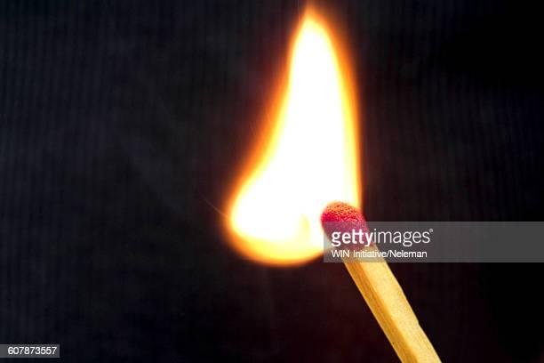 Close-up of a burning matchstick