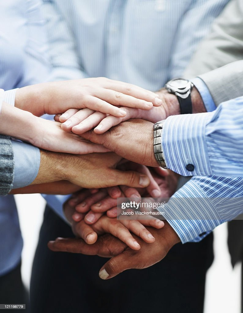 Closeup of a business people with hands together : Stock Photo