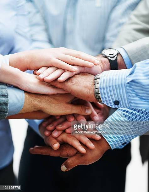 closeup of a business people with hands together - loyalty stock pictures, royalty-free photos & images