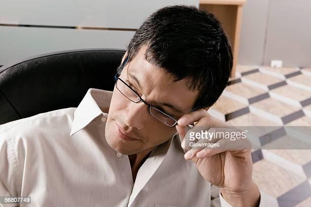 close-up of a businessman adjusting his eyeglasses - 外れる ストックフォトと画像