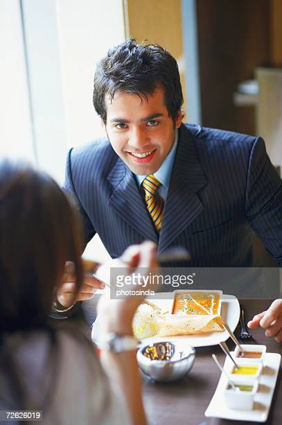 Close-up of a businessman and a businesswoman in a restaurant