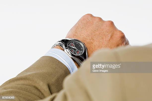 Close-up of a businessman checking the time
