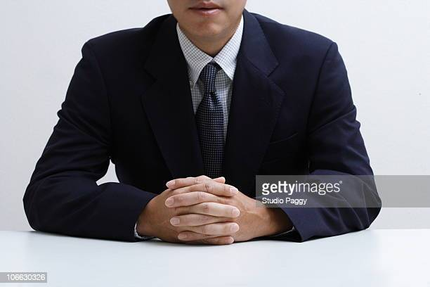 Close-up of a businessman clasping hands