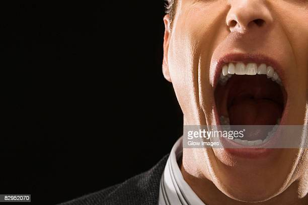 close-up of a businessman shouting - uvula stock photos and pictures