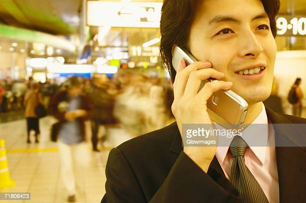 Close-up of a businessman talking on a mobile phone