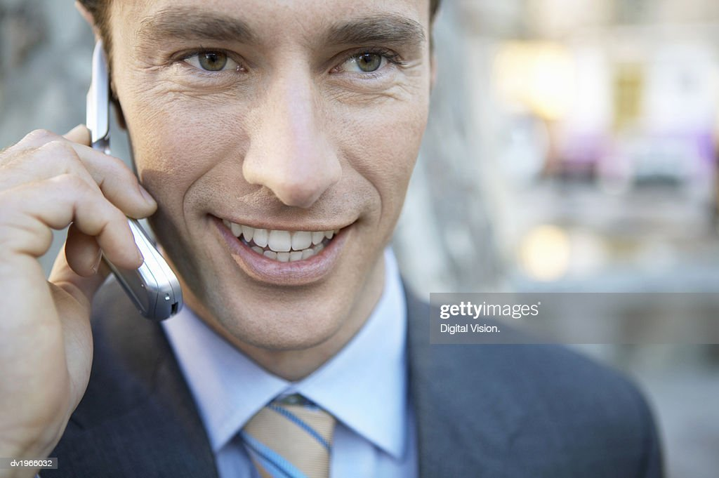 Close-up of a Businessman Talking on His Mobile Phone : Stock Photo