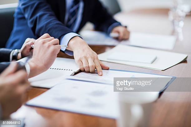 close-up of a businessmans hand - strategie stockfoto's en -beelden