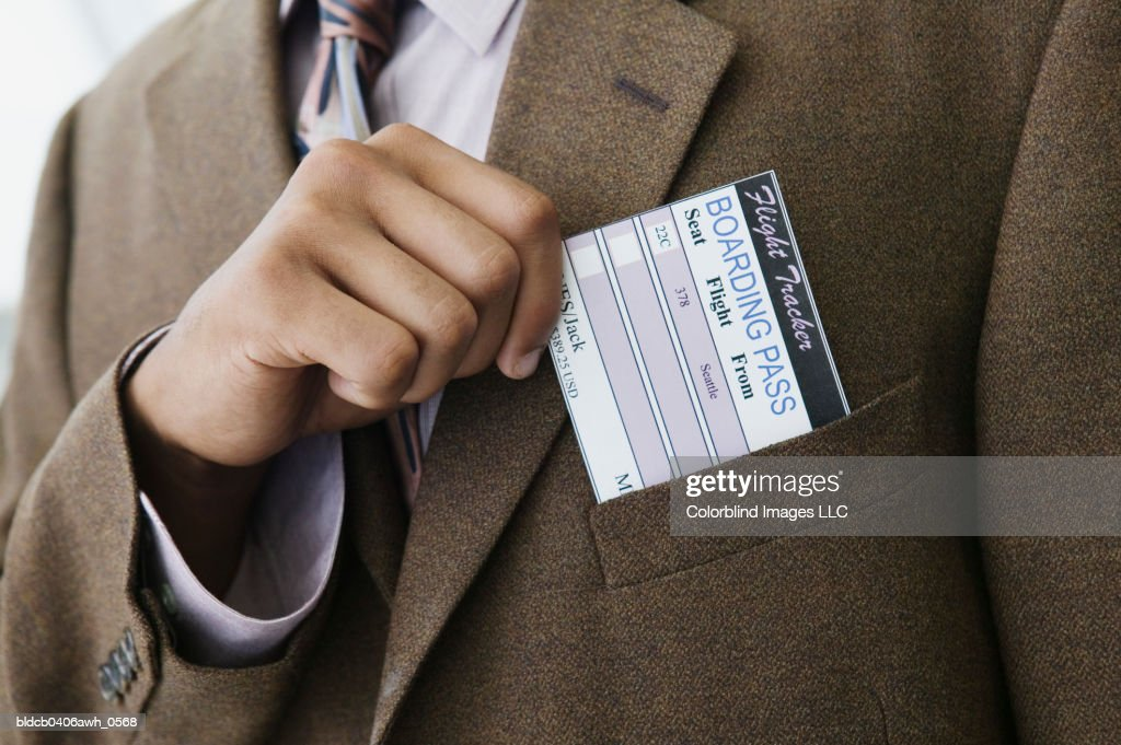 Closeup Of A Businessmans Hand Removing A Boarding Pass From A