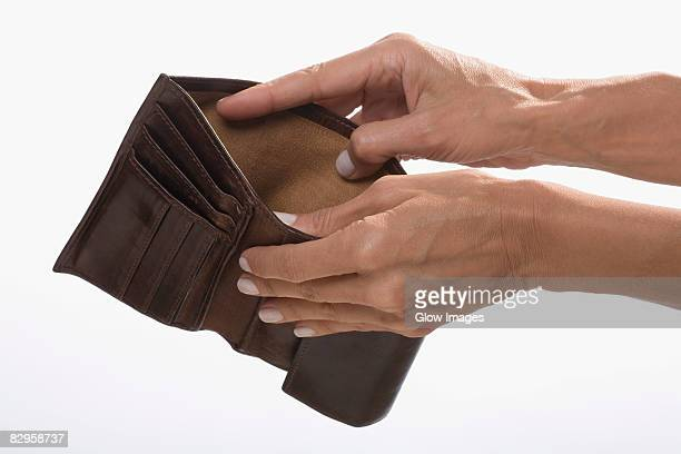 Close-up of a businessman's hands showing his empty wallet