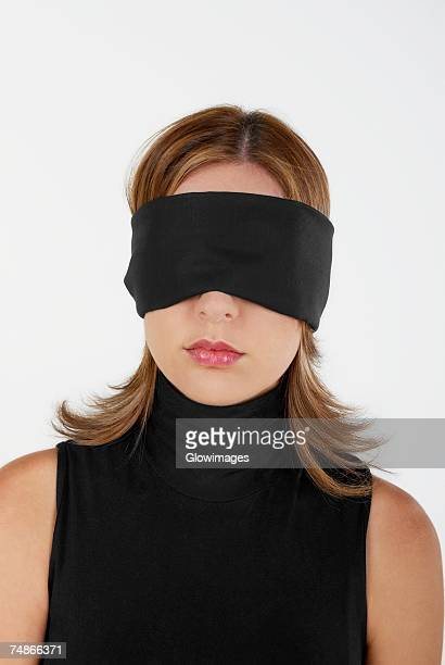 Close-up of a businesswoman blindfolded