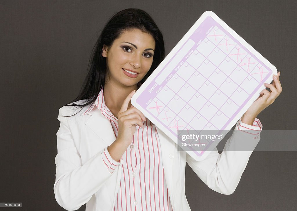 Close-up of a businesswoman holding a calendar : Foto de stock