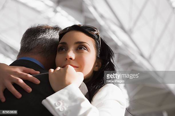 close-up of a businesswoman hugging a businessman - pareja hombre mayor y mujer joven fotografías e imágenes de stock