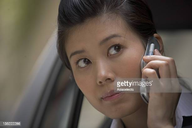 Close-up of a businesswoman using a mobile phone