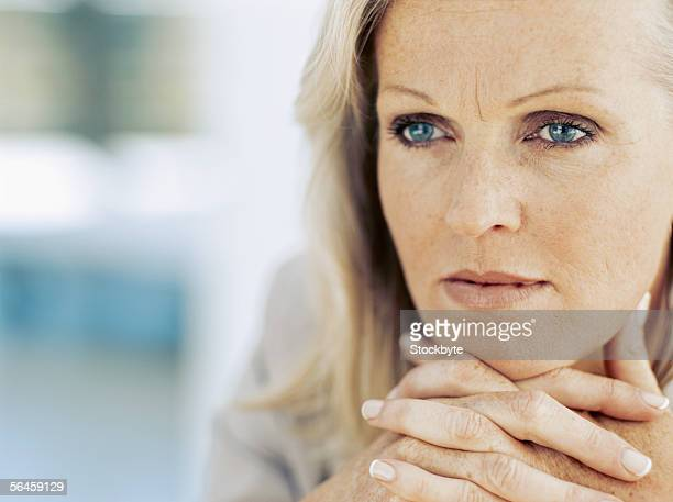 close-up of a businesswoman with her hands clasped