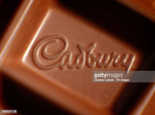 A closeup of a Cadbury logo in a bar of Dairy Milk chocolate US food giant Kraft today launched a hostile takeover bid for Dairy Milk maker Cadbury