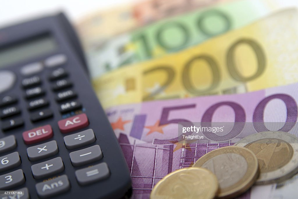 Close Up Of A Calculator And Foreign Paper Money Coin Stock Photo