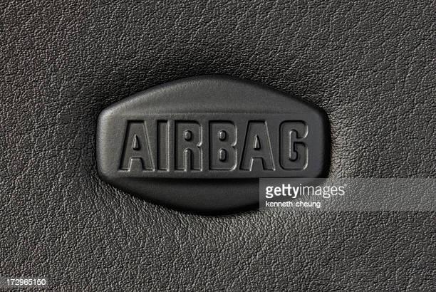 Close-up of a car airbag's sign