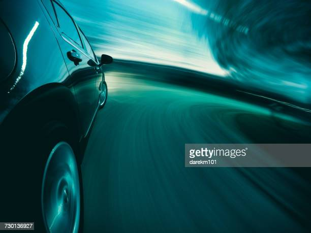 Close-up of a Car driving at speed on curved road
