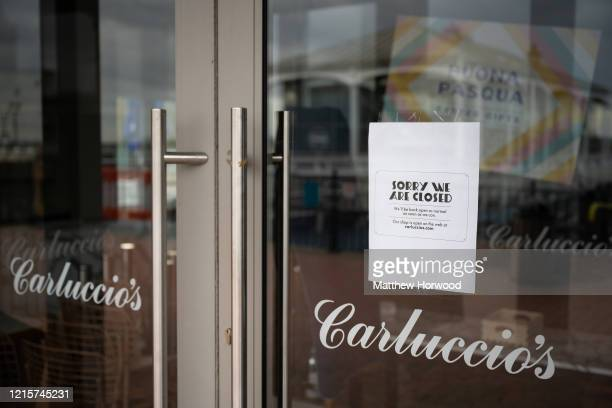 A closeup of a Carluccio's restaurant sign in Cardiff Bay on March 30 in Cardiff Wales Carluccio's has entered into administration due to problems...