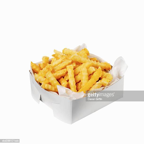 close-up of a carton of french-fries - french fries stock pictures, royalty-free photos & images