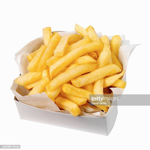 close-up of a carton of french-fries - fast food french fries stock pictures, royalty-free photos & images