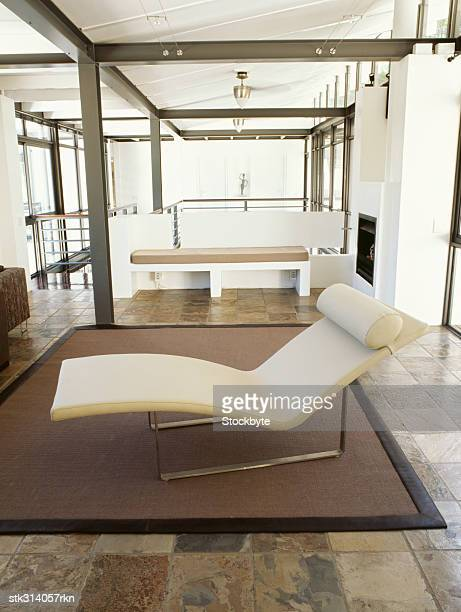 close-up of a chaise lounge in a living room - chaise longue stock photos and pictures