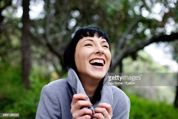 Close-up of a cheerful young woman outdoors