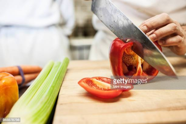 close-up of a chef using a knife to chop vegetables. - pepper vegetable stock pictures, royalty-free photos & images