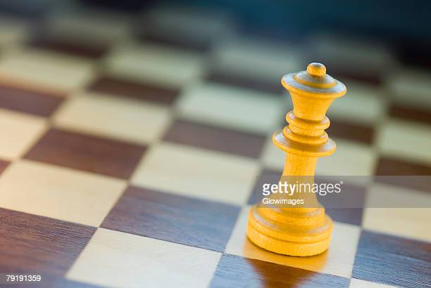 Close-up of a chess piece on a chessboard