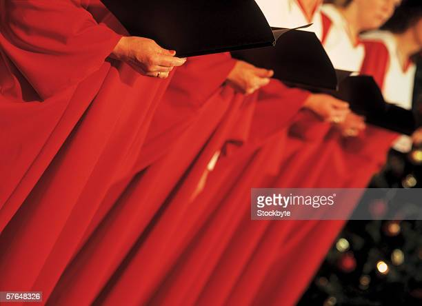 close-up of a choir group holding music books
