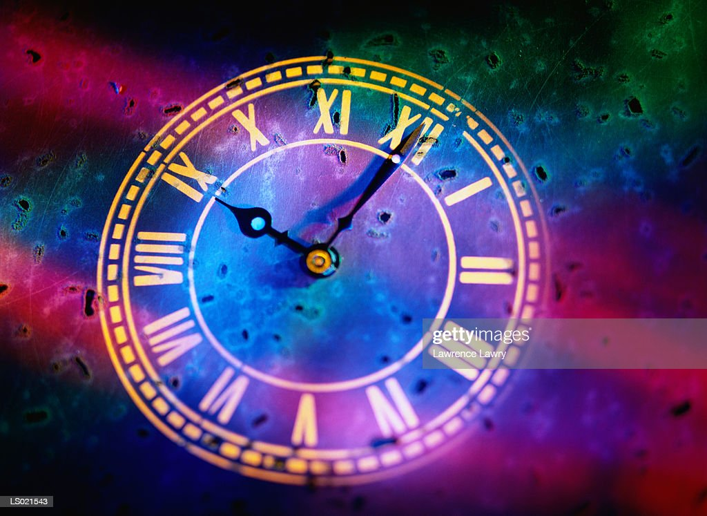 Close-up of a Clock with Roman Numerals : Stock Photo