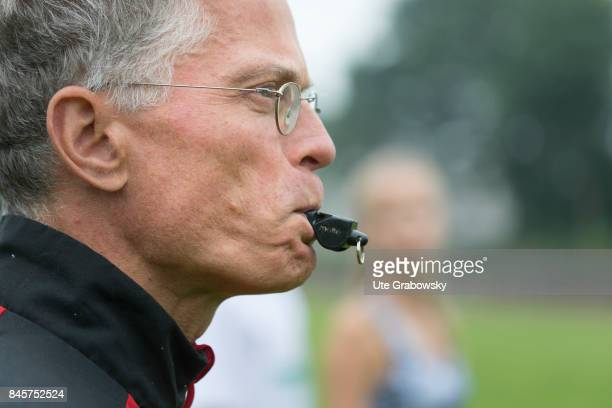 Closeup of a coach with whistle on a sports field Staged picture on August 10 2017 in Duelmen Germany