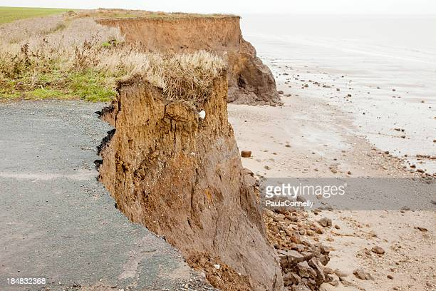 Close-up of a coastal road destroyed over time by erosion