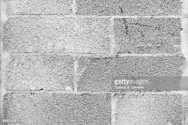 Close-up of a concrete block wall texture in black&white.