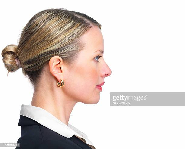 close-up of a confident young businesswoman - van de zijkant stockfoto's en -beelden
