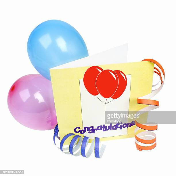 close-up of a congratulations card and balloons attached to streamers
