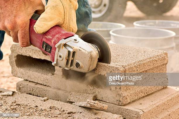 Close-up of a construction worker using an electric grinding tool