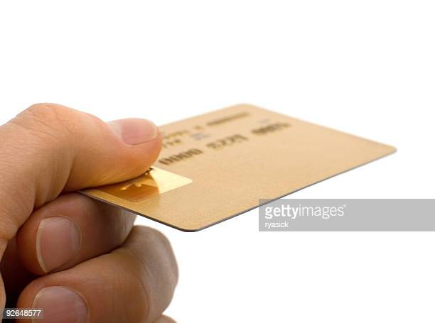 Closeup of a Consumers Hand Holding Gold Credit Card Isolated