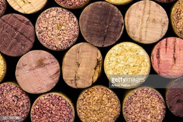 close-up of a cork wine with different variation of wine color - cork stopper stock pictures, royalty-free photos & images