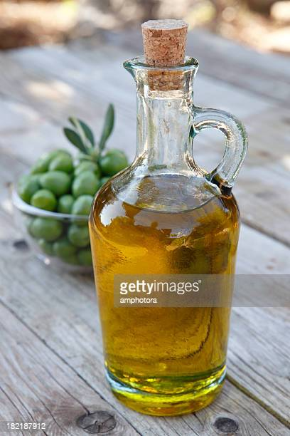 close-up of a corked bottle of olive oil - extra virgin olive oil stock pictures, royalty-free photos & images